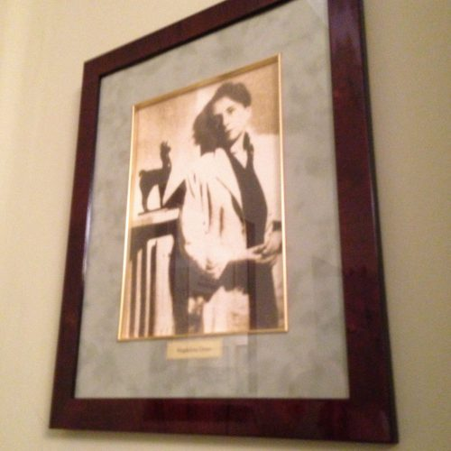 A photograph of Antonina Żabiński hangs on the wall.
