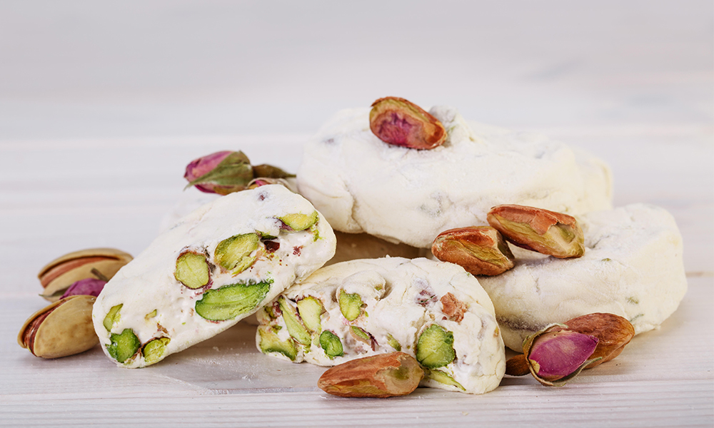 ID: a modern recreation of Manna, involving pistachios, white blobs of carbohydrates, and figs.
