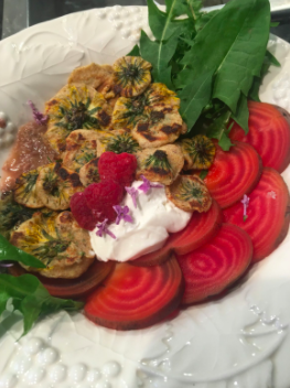 A dairy Shavuot meal: curried buttermilk dandelion fritters with rhubarb sauce, beets, dandelion greens, sour cream, berries and sugared lilac.