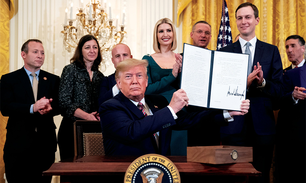 President Trump displays his signature on an executive order committing his administration to combating the rise of anti-Semitism, signed during an afternoon Hanukkah reception on December 11, 2019.