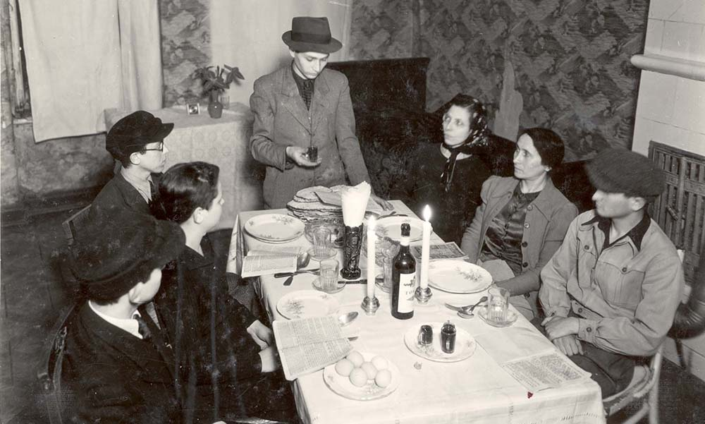 Jewish observance of Passover in the Warsaw Ghetto despite persecution during the Holocaust.